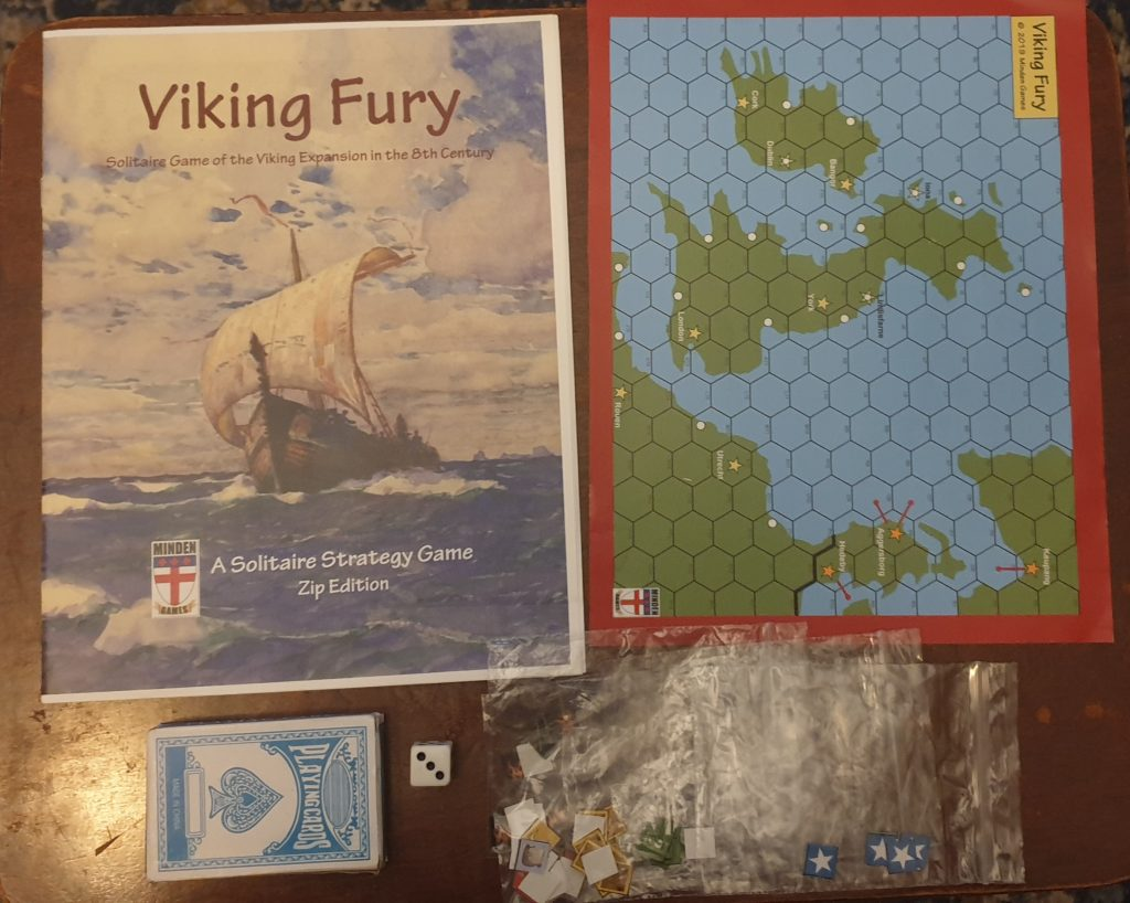 Picture of components, rulebook, map, counters and with added cards and die
